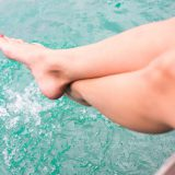 Relaxed feet splashing in water